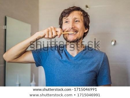 личной гигиены кавказский молодым человеком бамбук зубная щетка Сток-фото © galitskaya
