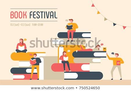 férfi · tart · köteg · könyvek · diák · fiatal - stock fotó © rastudio