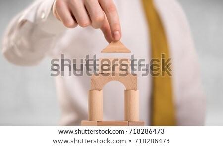 Zakenman gebouw toren jonge knap houten Stockfoto © ra2studio