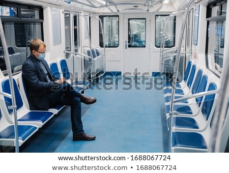 Prevention in public transport, health awareness for pandemic protection. Young man wears medical ma Stock photo © vkstudio