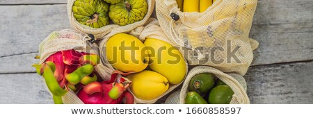 BANNER, LONG FORMAT Fruit in a reusable bag on a stylish wooden kitchen surface. Zero waste concept, Stock photo © galitskaya