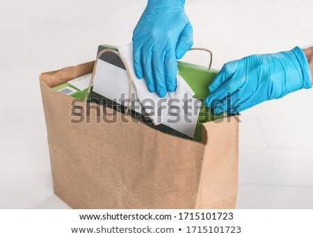 Disinfection of food home delivery sanitizing packages of online shopping bag with disinfecting wipe Stock photo © Maridav