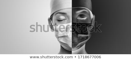 Two dark sides of COVID-19. Sad doctor with closed eyes tired wearing mask with face divided in blac Stock photo © Maridav