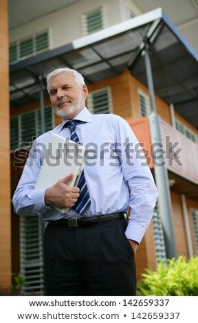 Grey-haired business on his way to client Stock photo © photography33