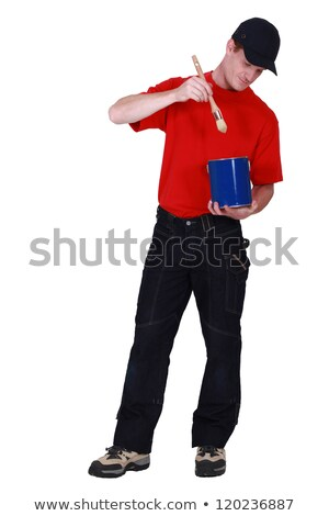 Man dipping his paintbrush into a paint can Stock photo © photography33