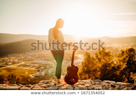woman holding a guitar stock photo © photography33