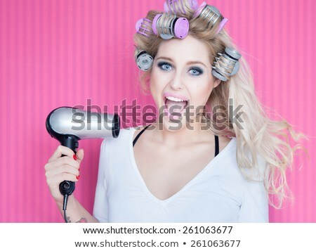 Attractive blond girl with a drier Stock photo © Nejron