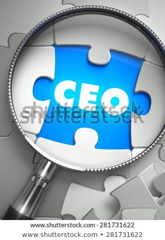 CEO - Puzzle with Missing Piece through Loupe. Stock photo © tashatuvango