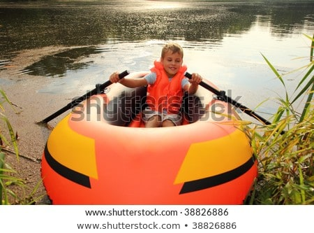 boy sits on an inflatable boat on lawn Stock photo © Paha_L
