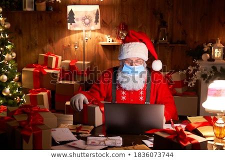 mikulás · dolgozik · karácsonyfa · otthon · olvas · boldog - stock fotó © HASLOO
