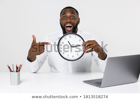 business man running on clock background stock photo © rastudio