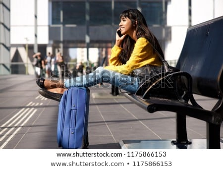 Indian woman with suitcase talking on phone Stock photo © studioworkstock