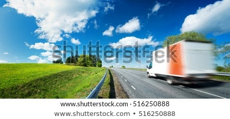 White truck moving on the road in a natural landscape at sunset Stock photo © alphaspirit