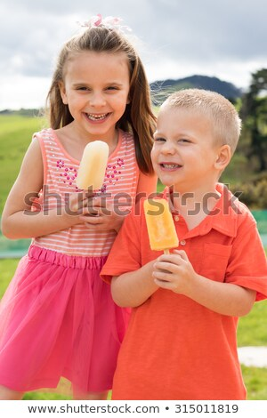Boy and girl eating popsicle Stock photo © colematt