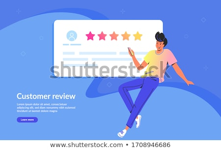 service rating concept of young man using smartphone to leave a feedback concept of feedback testi stock photo © makyzz