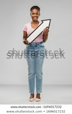 african woman with arrow showing north east Stock photo © dolgachov