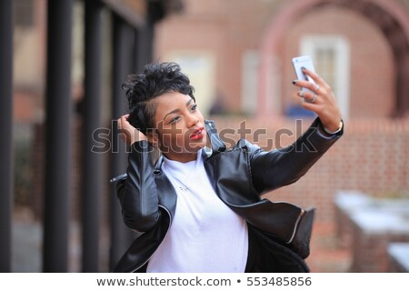 african american woman closing ears by hands Stock photo © dolgachov