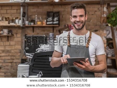 Portrait of smiling male staff standing near counter Stock photo © wavebreak_media