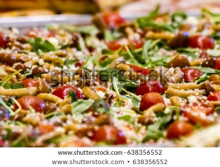 Stock photo: Pizza with mushrooms, rocket salad and cheese flakes
