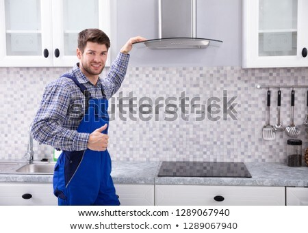 Male Electrician Standing In Front Of Extractor Filter Stock photo © AndreyPopov