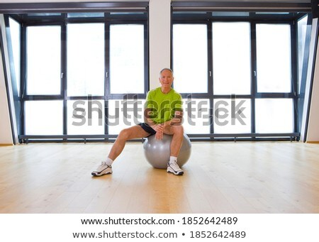 Front view of happy senior man with hand clasped looking at camera in home Stock photo © wavebreak_media