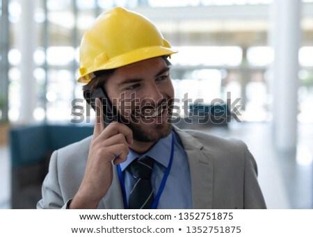gelukkig · zakenvrouw · mobiele · telefoon · kantoor - stockfoto © wavebreak_media
