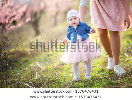 Outdoors mom and baby in autumn in public Park for a walk. Stock photo © ElenaBatkova