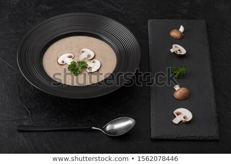 Nero ciotola piatto ippocastano champignon Foto d'archivio © DenisMArt