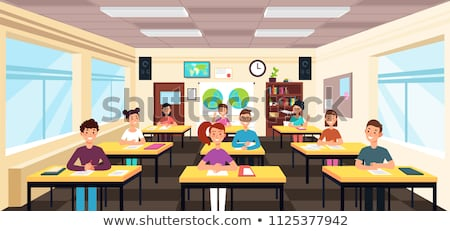 schoolboys seated at desk in classroom Stock photo © photography33
