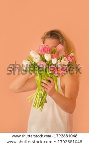 rubio · delgado · mujer · flor · pared · dama - foto stock © dashapetrenko