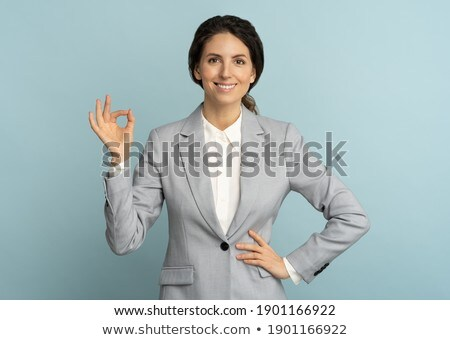 Portrait of a smiling woman showing ok sign Stock photo © deandrobot