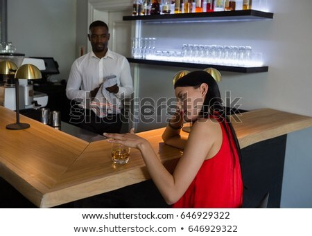 Bar tender looking at depressed woman by counter Stock photo © wavebreak_media