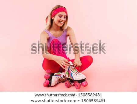 portrait of sporty woman smiling while tying shoelace stock photo © wavebreak_media