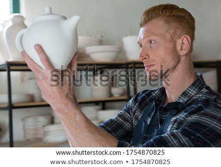Male potter examining a teapot Stock photo © wavebreak_media