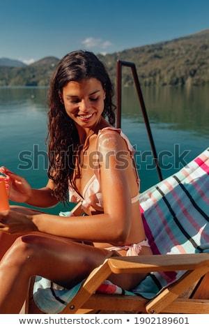 Jeune femme bikini pier rivière vue arrière bois Photo stock © boggy