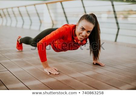 若い女性 遊歩道 を実行して 午前 都市 ヘッドホン ストックフォト © boggy