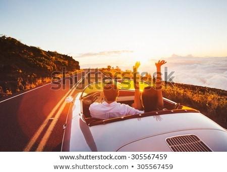 happy couple driving in convertible car Stock photo © dolgachov