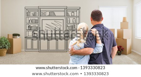 couple inside empty room with moving boxes facing entertainment stock photo © feverpitch