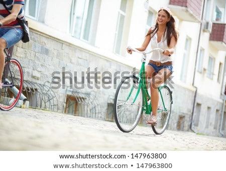 jonge · vrouw · paardrijden · fiets · buiten · jonge · mooie · vrouw - stockfoto © Lopolo