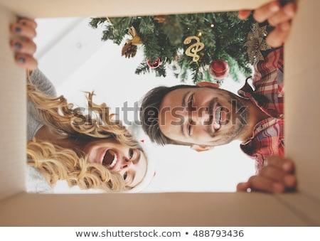 happy couple opening christmas gift box Stock photo © dolgachov