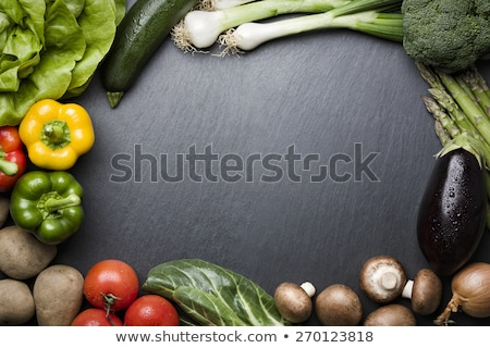 Arrangement of mixed vegetables on dark stone copyspace. Stock photo © lichtmeister
