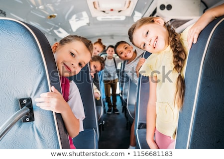 School Bus and Pupils, Schoolboy and Schoolgirl Stock photo © robuart