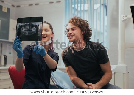 Girl Having His Teeth Examined By A Dentist Stock photo © AndreyPopov