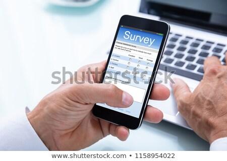 Riempimento online sondaggio forma laptop Foto d'archivio © AndreyPopov