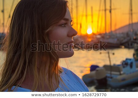 A woman travels to the Mediterranean sea countries on a tourist yacht Stock photo © ElenaBatkova