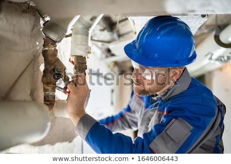 Male Worker Inspecting Valve Stock photo © AndreyPopov