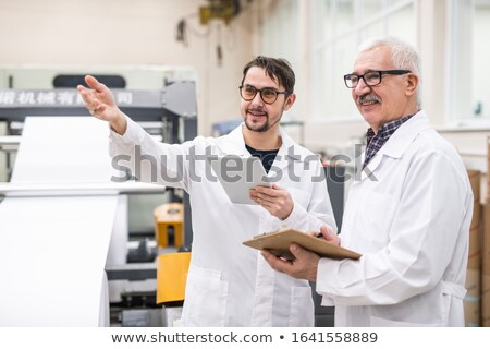 Analyzing printing press productivity Stock photo © pressmaster