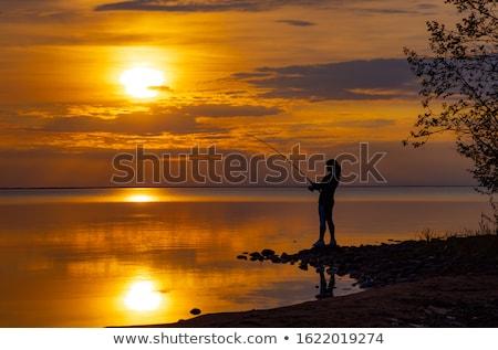 Kobieta połowów wędka Norwegia słońce krajobraz Zdjęcia stock © cookelma
