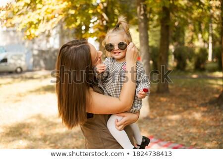 Foto jovem alegre mulher pirulito Foto stock © deandrobot