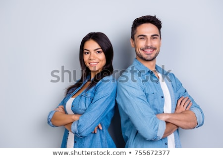 Image of two excited women smiling and standing with arms crosse Stock photo © deandrobot